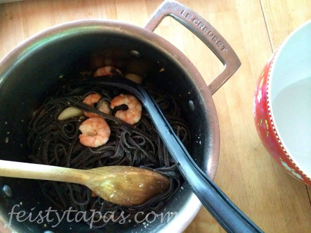 Squid Ink Pasta with Prawns all mixed in the pan