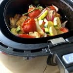 Photo showing the delicious Air Fryer Roasted Mediterrean Vegetables with Halloumi Cheese recipe by Feisty Tapas in the drawer of a black Philips air fryer