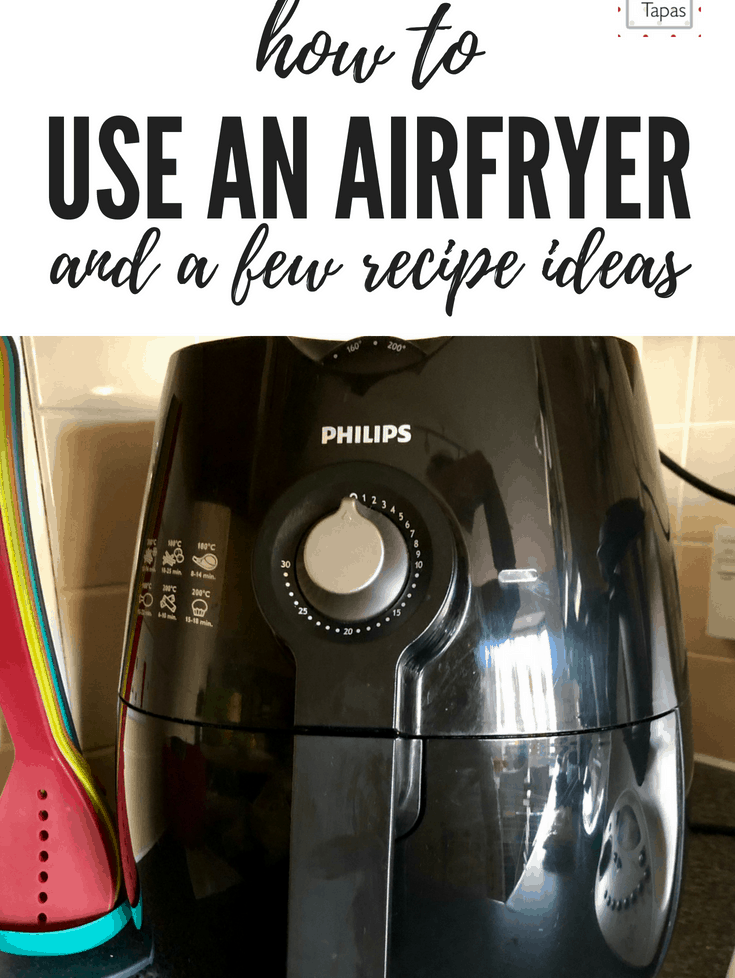 How to use an air fryer. Photo of Philips Air fryer with the words How to use an air fryer and a few recipe ideas. A Philips air fryer is shown on the photo and a colourful rainbow set of Joseph Joseph kitchen utensils on the left of the photo