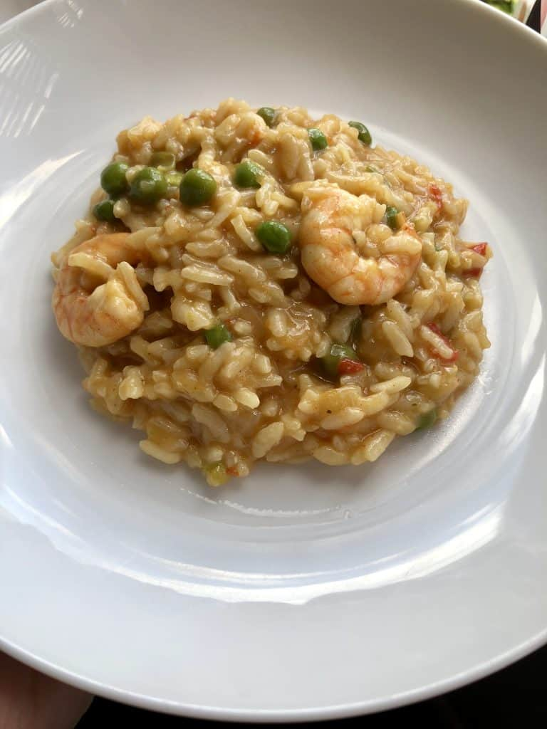Instant Pot Prawn Trout and Pea Risotto looking served on a white plate