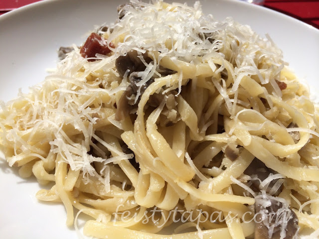 Garlic and serrano ham mushrooms tossed with cooked pasta