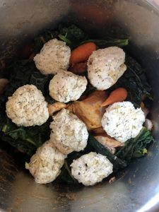 Instant Pot Chicken Stew with Suet-Free Dumplings - about to be pressure cooked. All the ingredients are in: chicken thigh fillets, carrots, cavolo nero, dumplings, etc. in the Instant Pot DUO's stainless steel inner pot. Ready to be pressure cooked