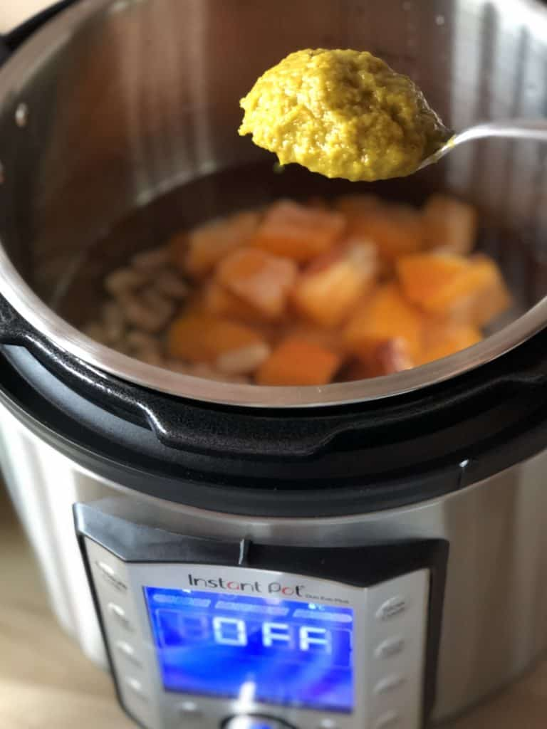 Vegetable Stock Paste being added to Instant Pot Duo Evo Plus Cavolo Nero and Buttternut Squash soup