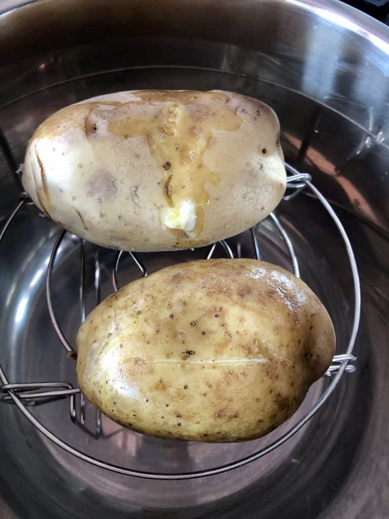 Butter on baking potatoes and ready to crisp up