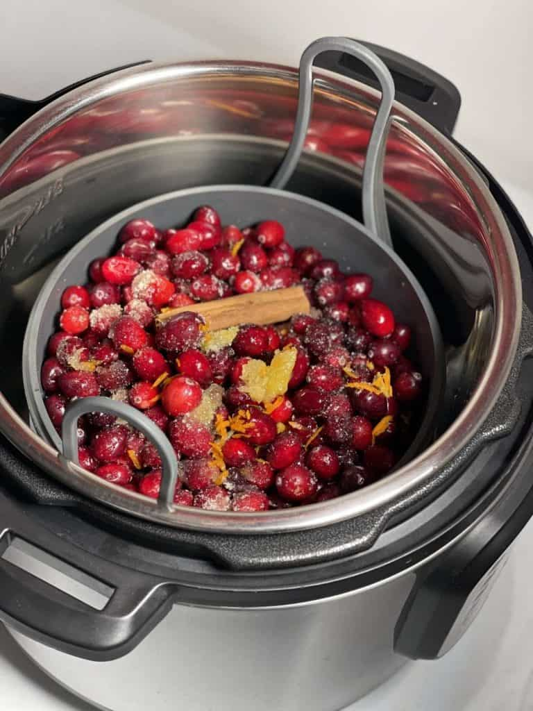 How to pressure cook Cranberry Sauce (with Instant Pot instructions) - all ingredients in the Instant Pot silicone steamer set cake pan and trivet steamer rack
