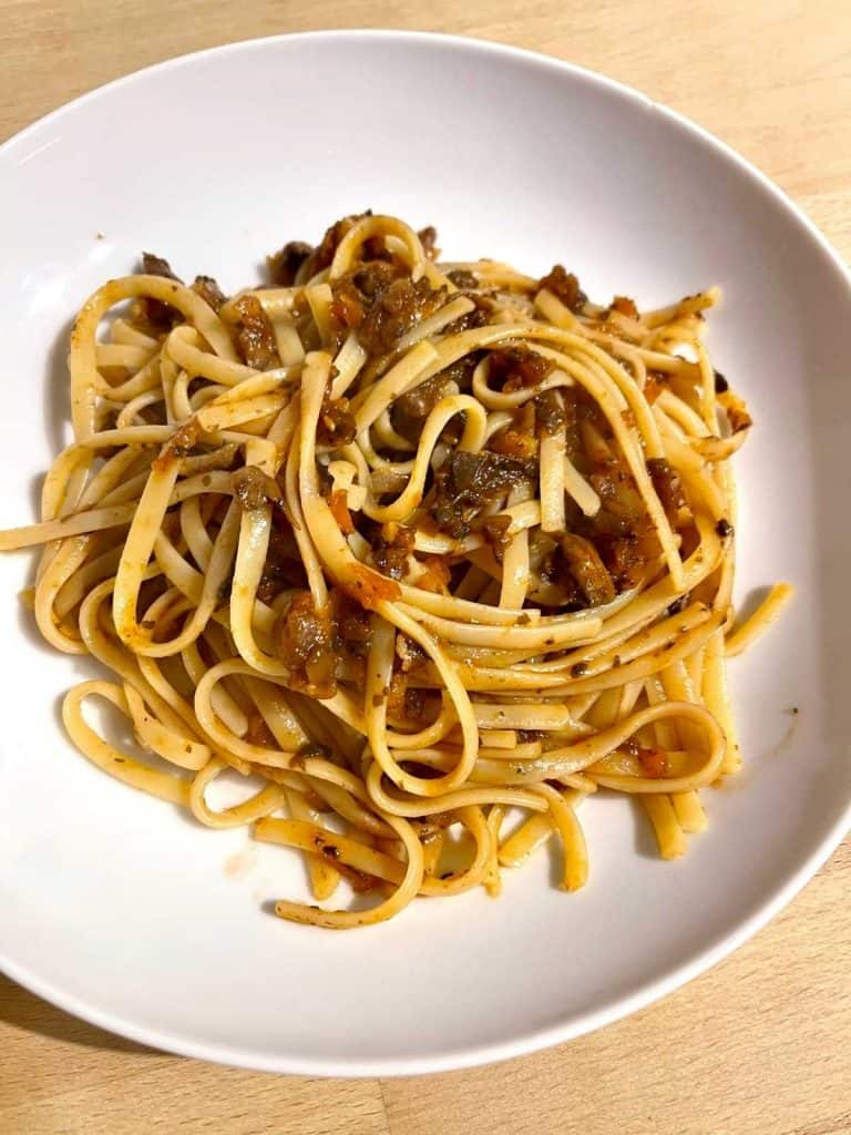 Instant Pot Mushroom Bolognese recipe served on deep white plate with linguine pasta