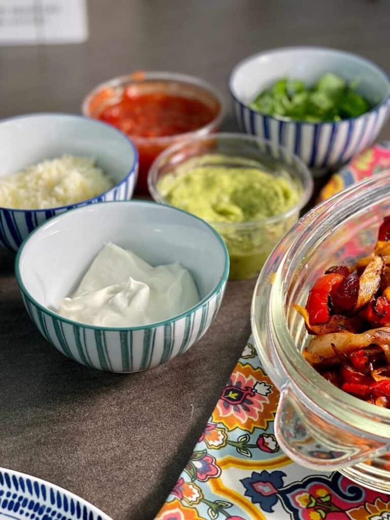 Toppings: soured cream, guacamole, coriander cilantro, salsa and grated cheese